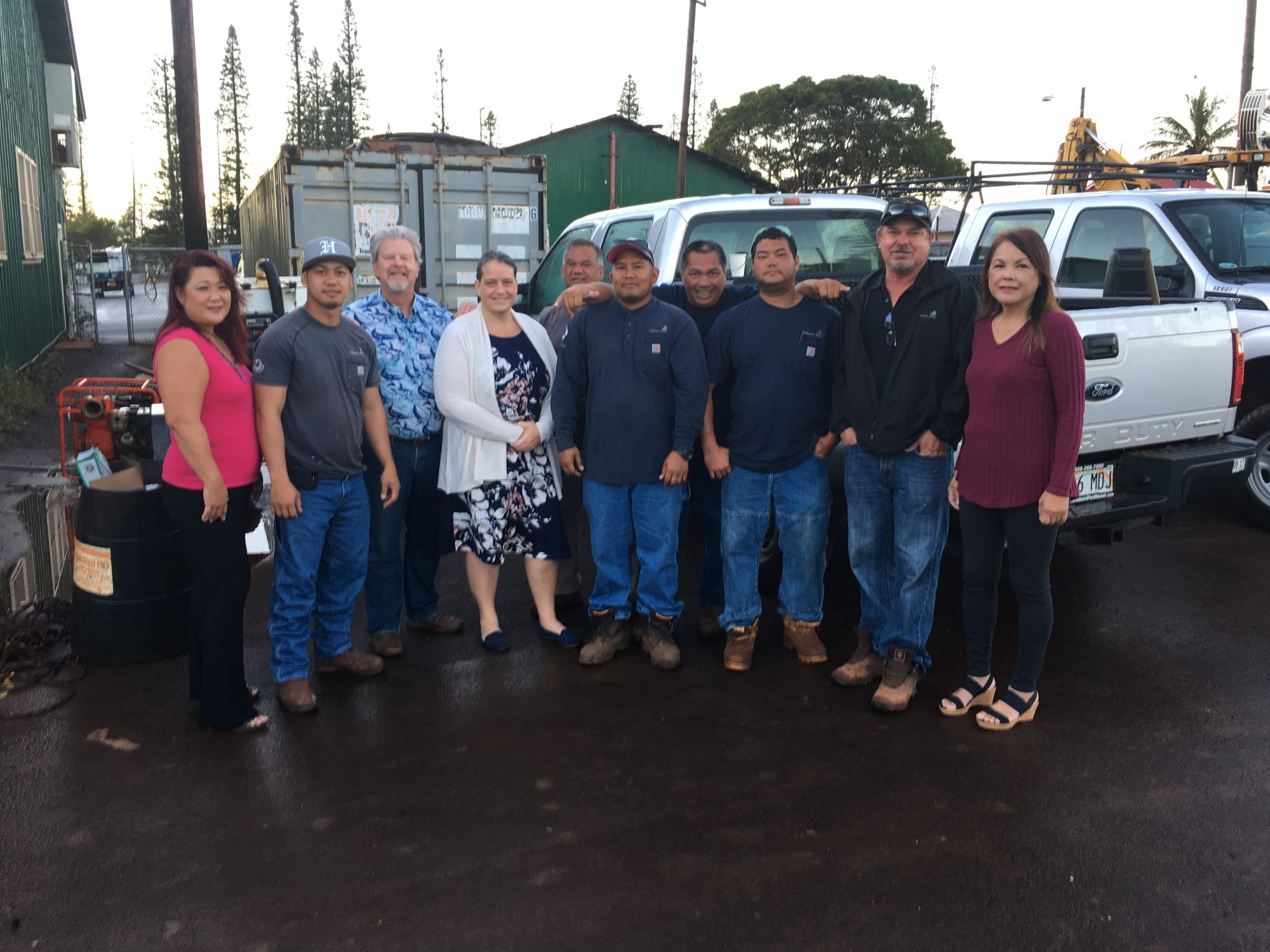 Group photo of 10 Lanai Water Company staff members in parking lot